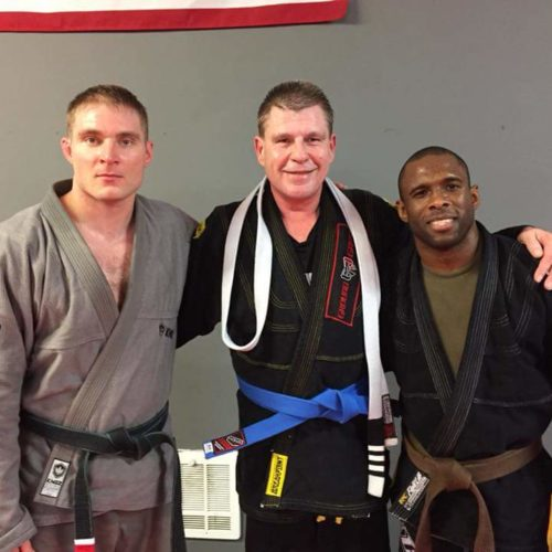Coaches and Student Celebrating a Belt Promotion